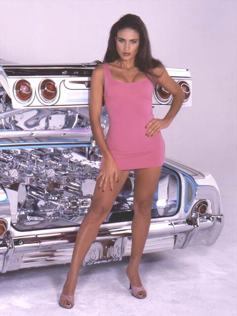 Zoom Wanda Acuna Standing In A Pink Dress Hand On Hip on 2002 Cadillac Escalade
