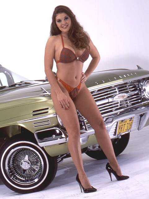 Zoom Jennifer Flores Standing In Plaid Bra And Panties on 2003 Chevy Impala