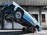 lrmp_0812_01_pl-1977_cadillac_coupe_de_ville-front_wheels_hopping