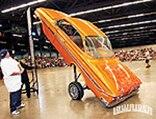 lrmp_0901_01_pl-portland_lowrider_hop_show-orange_impala_hopping