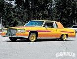 lrmp_0903_01_pl-1983_cadillac_fleetwood_brougham-front_driver_view