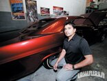 lrmp_0903_12_pl-armando_flores-posing_next_to_car
