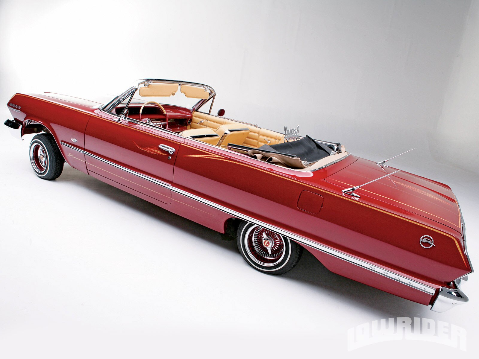 0911-lrmp-05-o-1963-chevy-impala-convertible-top-down1