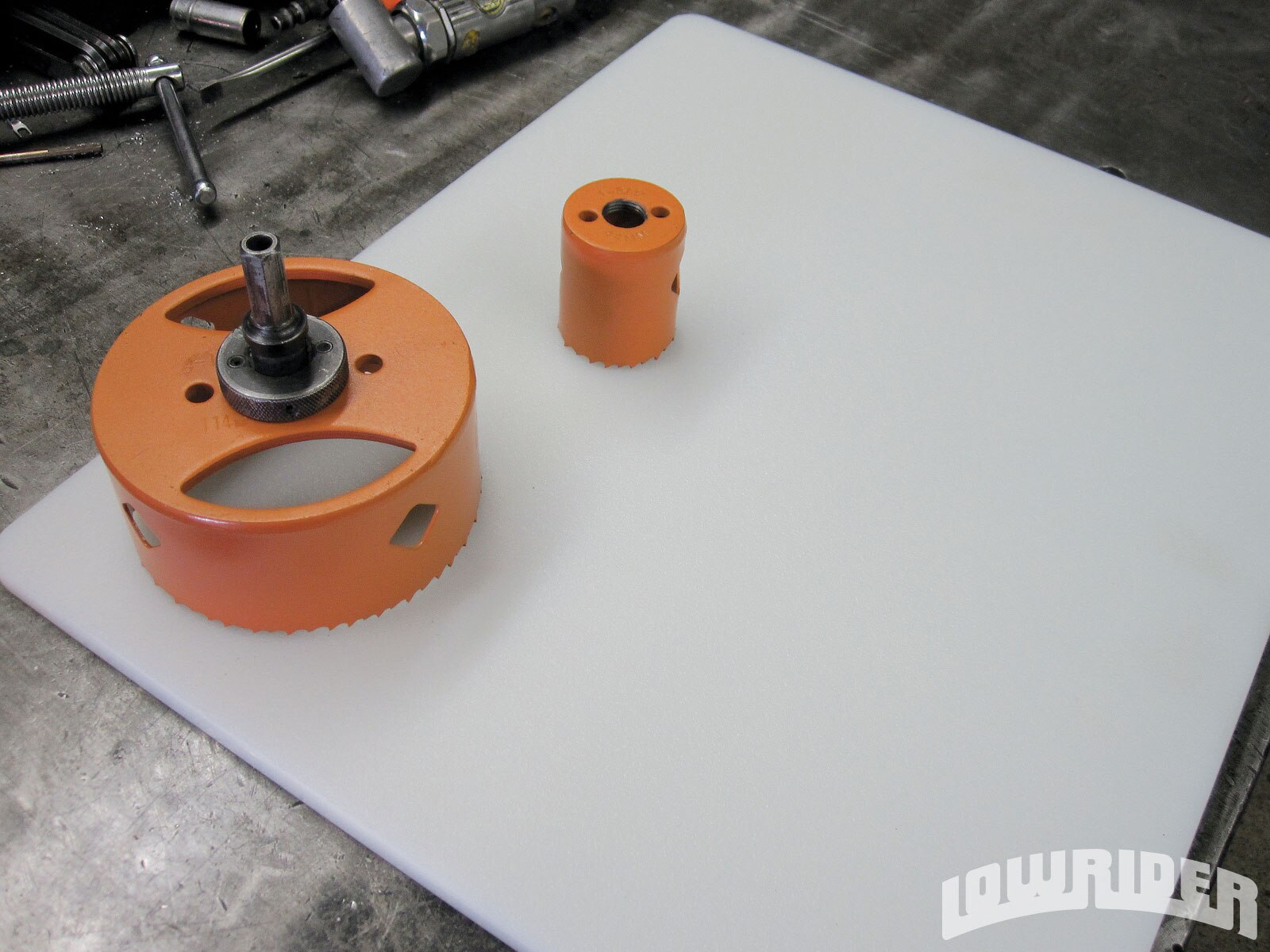 <strong>2.</strong> There are a few things for this tech that you will need, including these two hole saws. The bigger diameter is a 4-inch, and the center is 1 3/4 the size of the hydraulic cylinder.