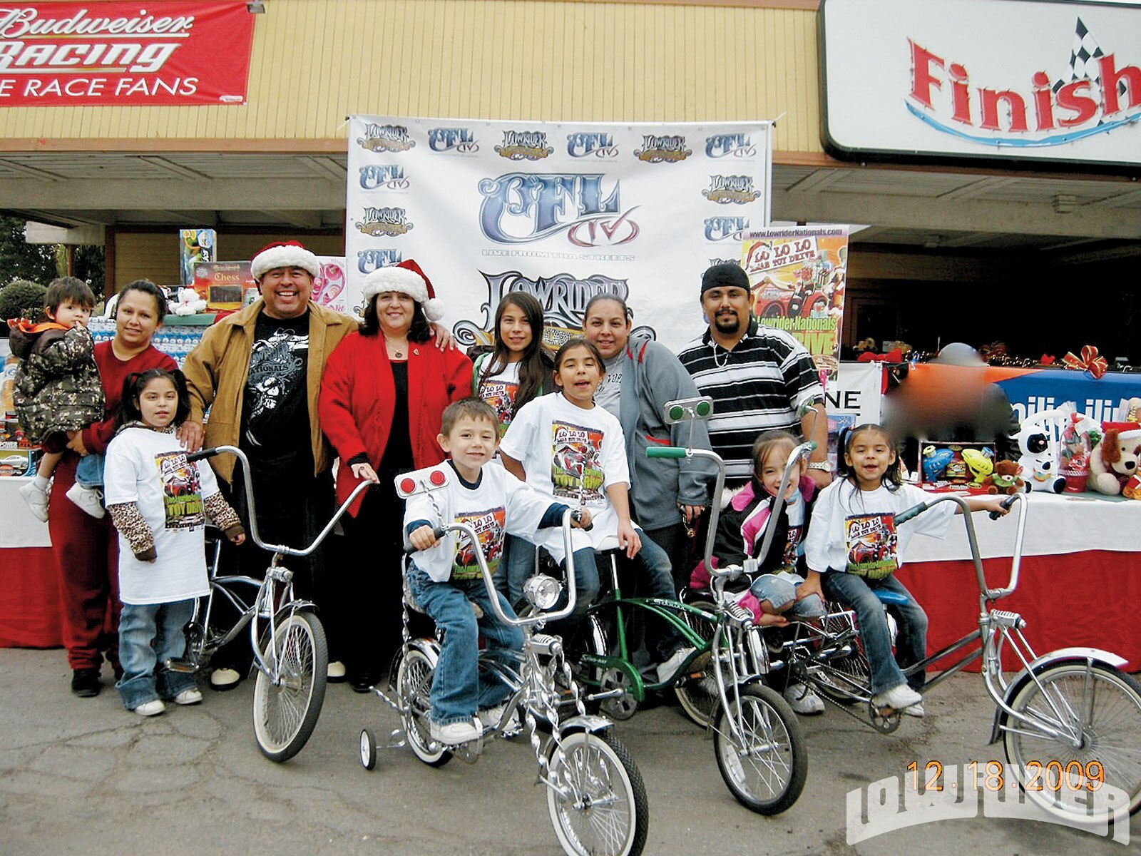 Smiles for toys at the Lowrider Nationals Toy Drive.