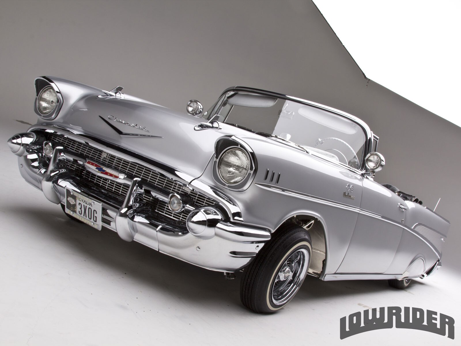 1202-lrmp-13-o-1957-chevrolet-bel-air-driver-side-front-view