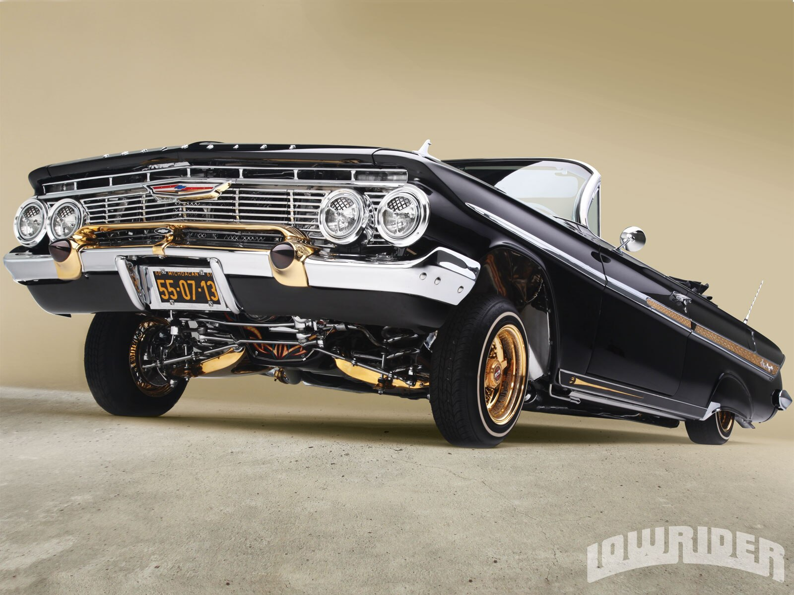 1206-lrmp-02-o-1961-chevrolet-impala-convertible-driver-side-front-view1