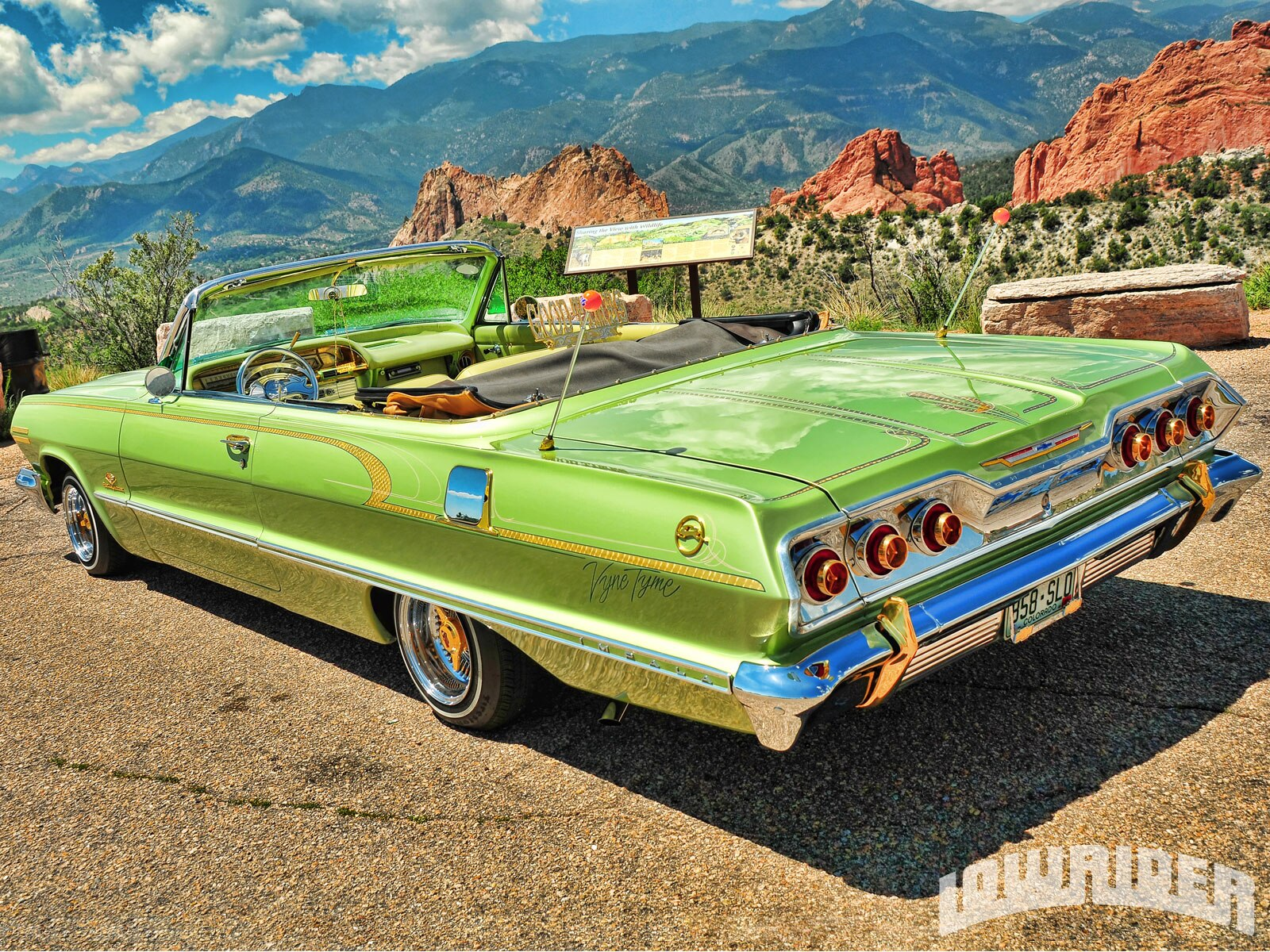 1210-lrmp-01-o-1963-chevrolet-impala-convertible-driver-side-rear-quarter-view1