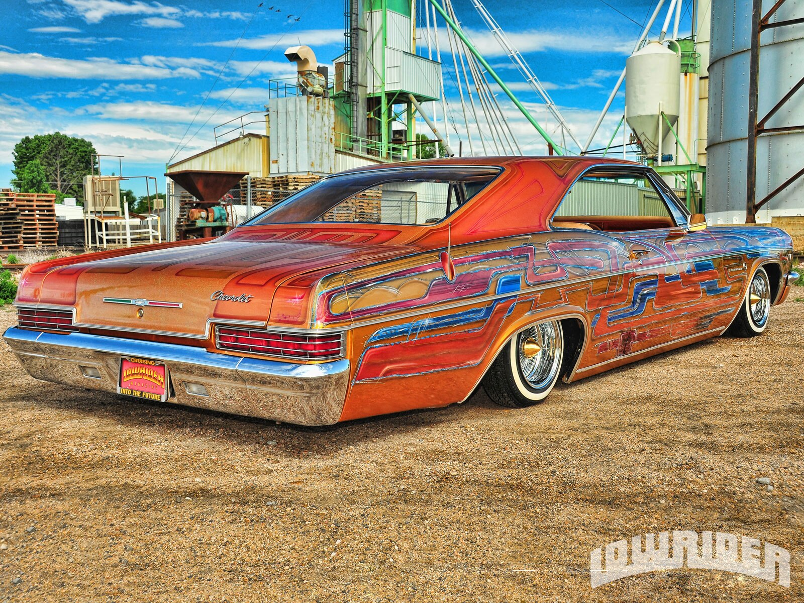 1210-lrmp-01-o-1966-chevrolet-impala-passenger-side-rear-quarter-view1