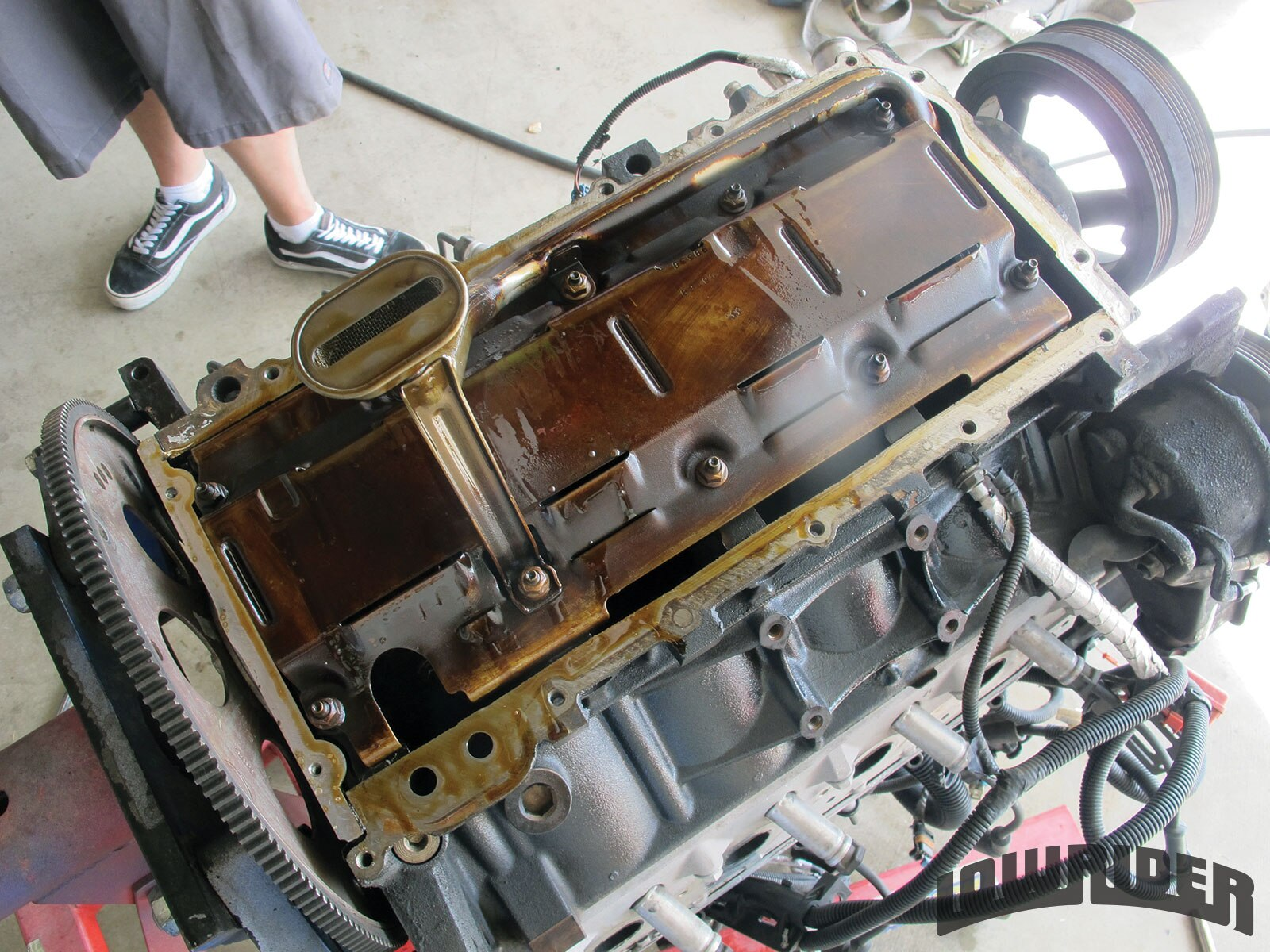 <strong>5</strong>. With all of the oil drained, we were able to flip the engine so we could work on swapping out the oil pickup tube.