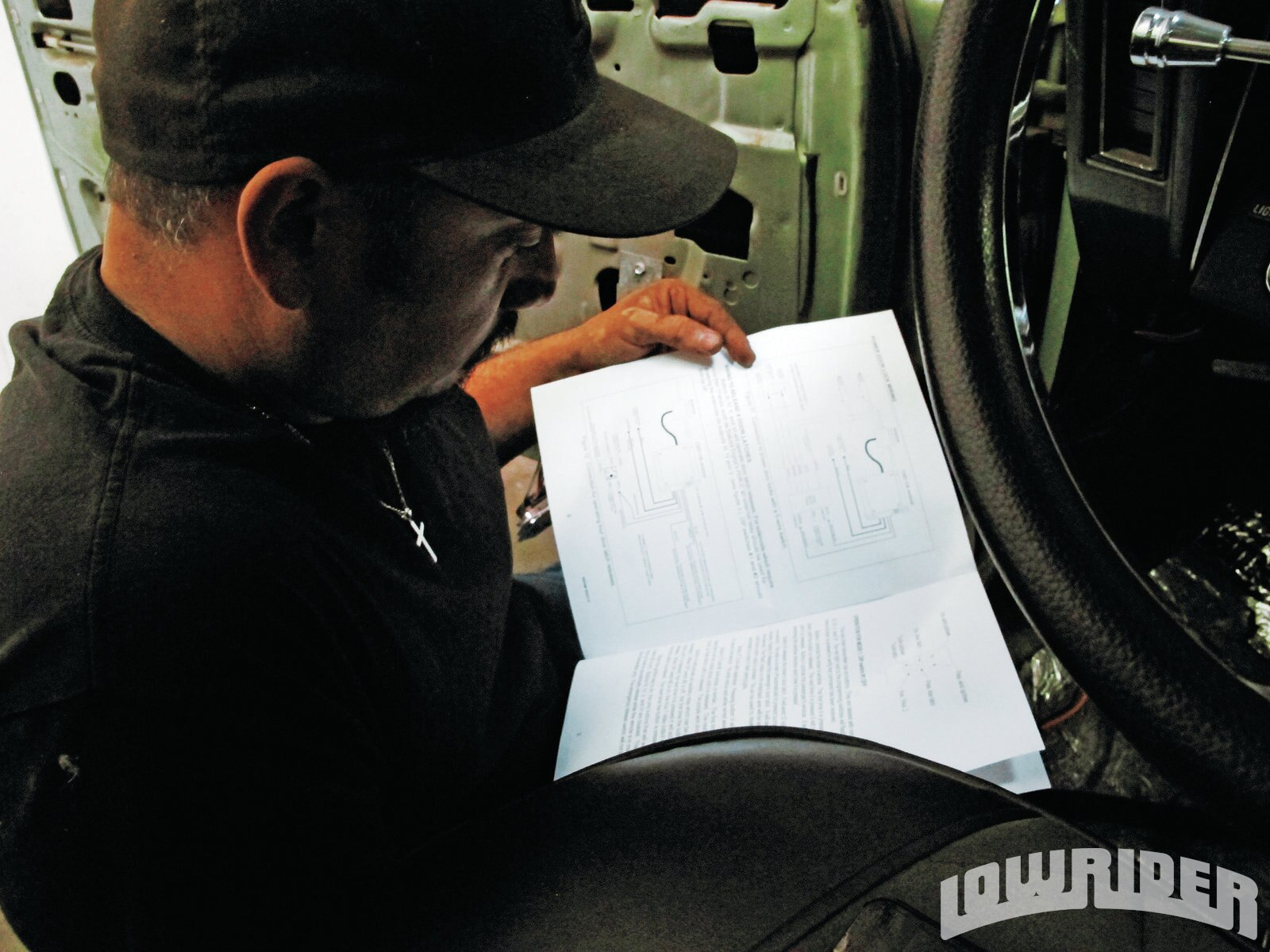 <strong>16</strong>. With the wiring box tucked away, Mario referred to the installation guide to double check the simple but time consuming part of the tech.