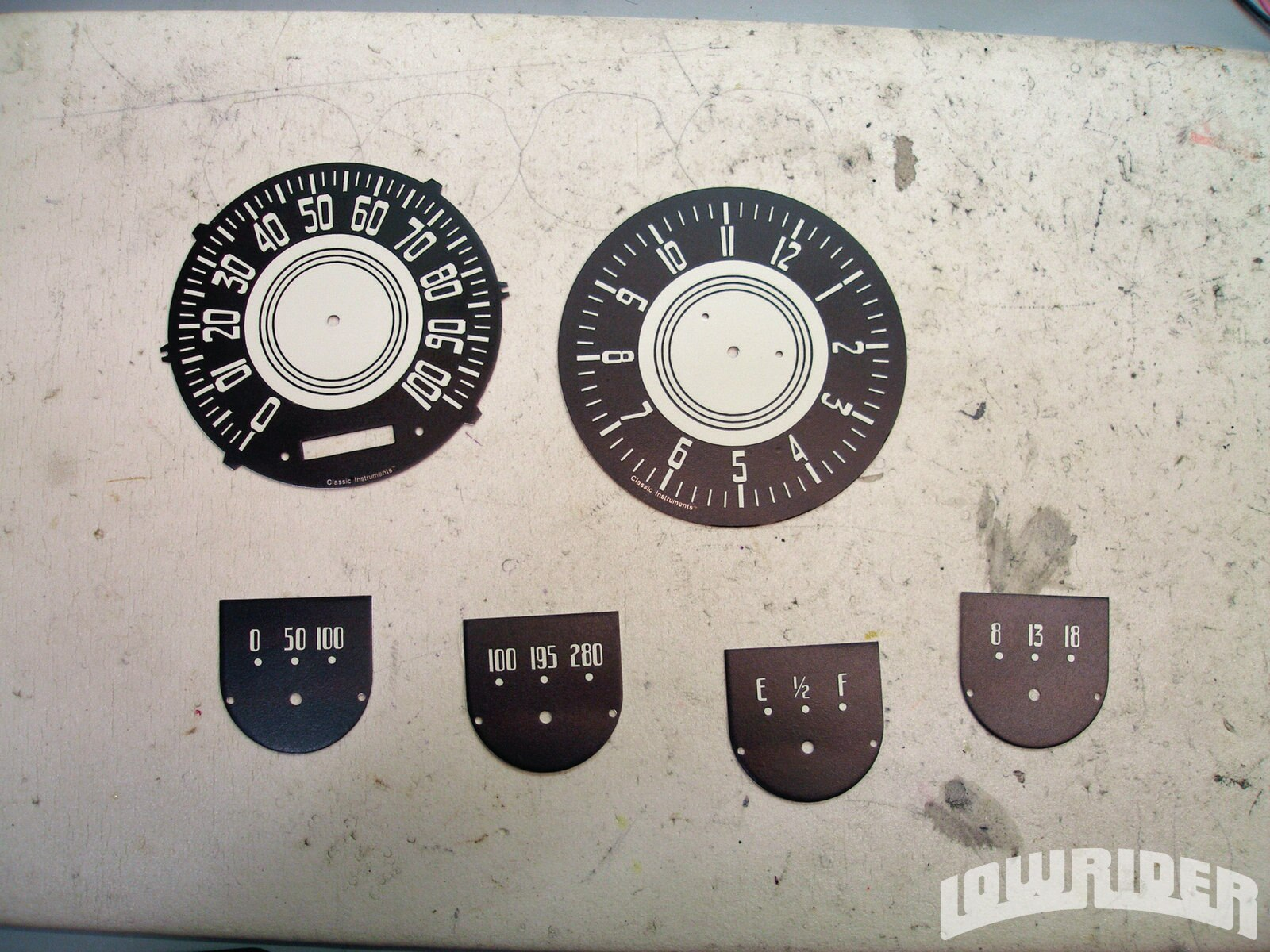 <strong>8-9</strong>. Completed graphics are applied to freshly painted dial faces. With the minor exception of the Classic Instruments name at the bottom, the average person would be hard-pressed to tell the difference between these and a set of NOS ones.