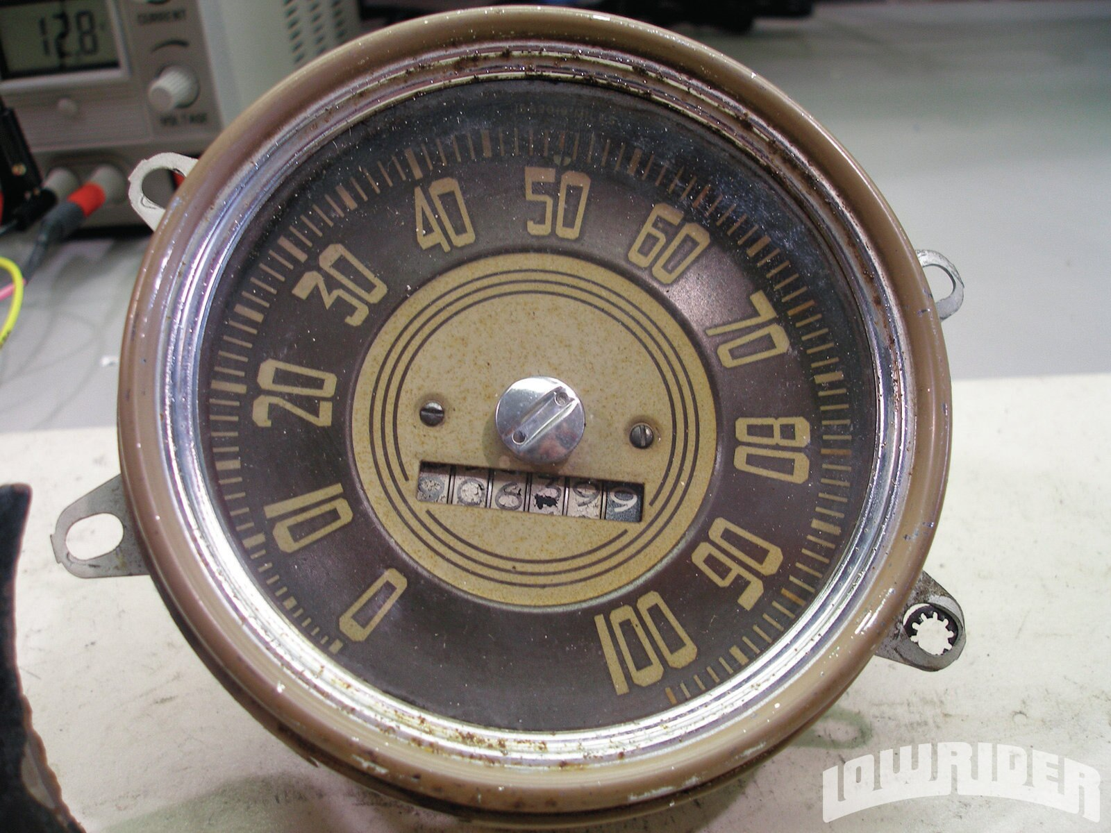 <strong>5</strong>. Besides visually evaluating the gauges condition wise (note the bezels are only partially painted here—they were pitted pretty badly, and since replacements aren't available, they would get painted completely instead), the Custom Team prepares for the designing the gauge-face graphics.