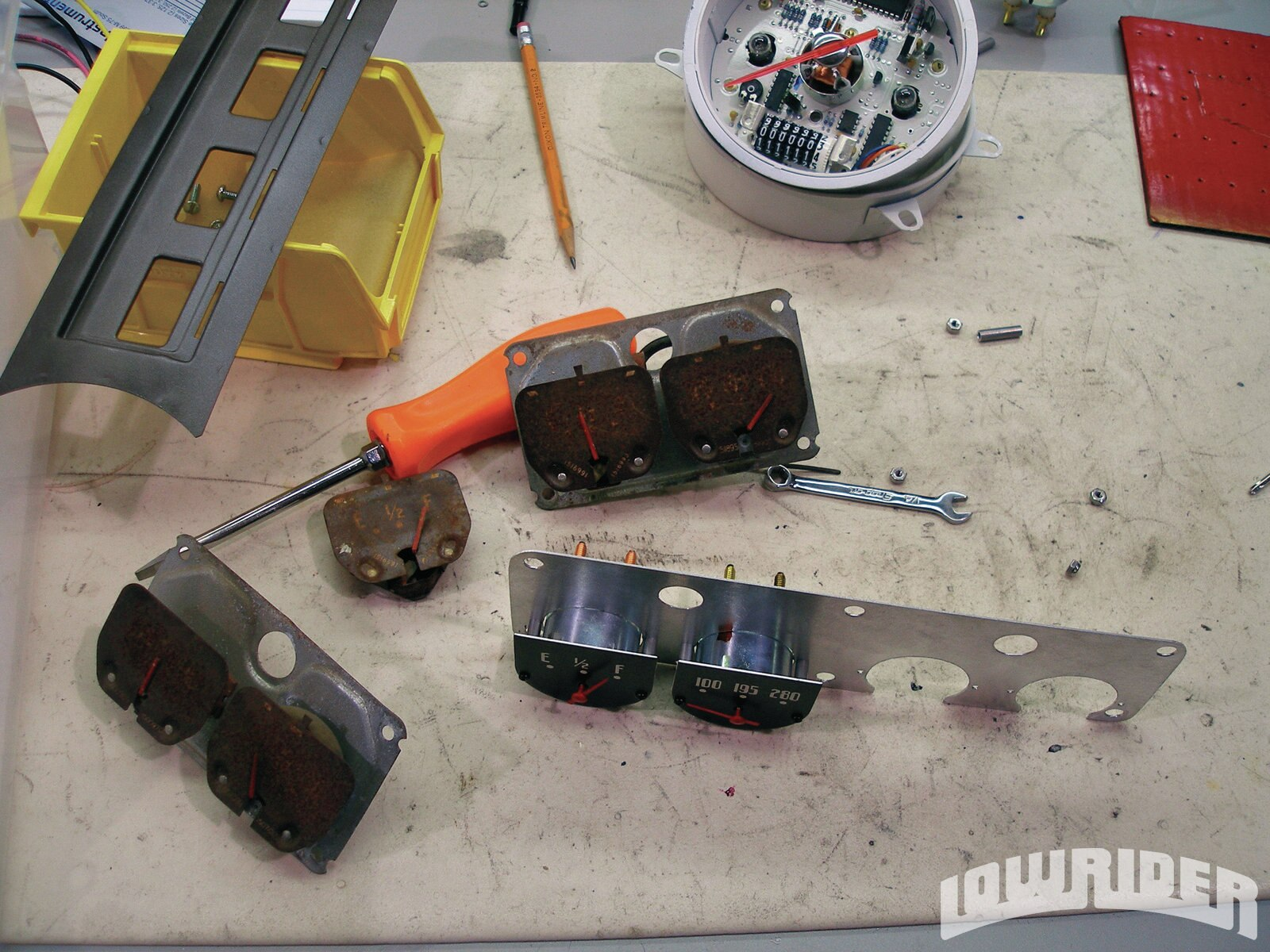 <strong>14</strong>. The process for the horizontal gauge cluster is pretty much the same, but a little different—each stock gauge mechanism is replaced with electronic units like the ones found in Classic's smaller round gauges.