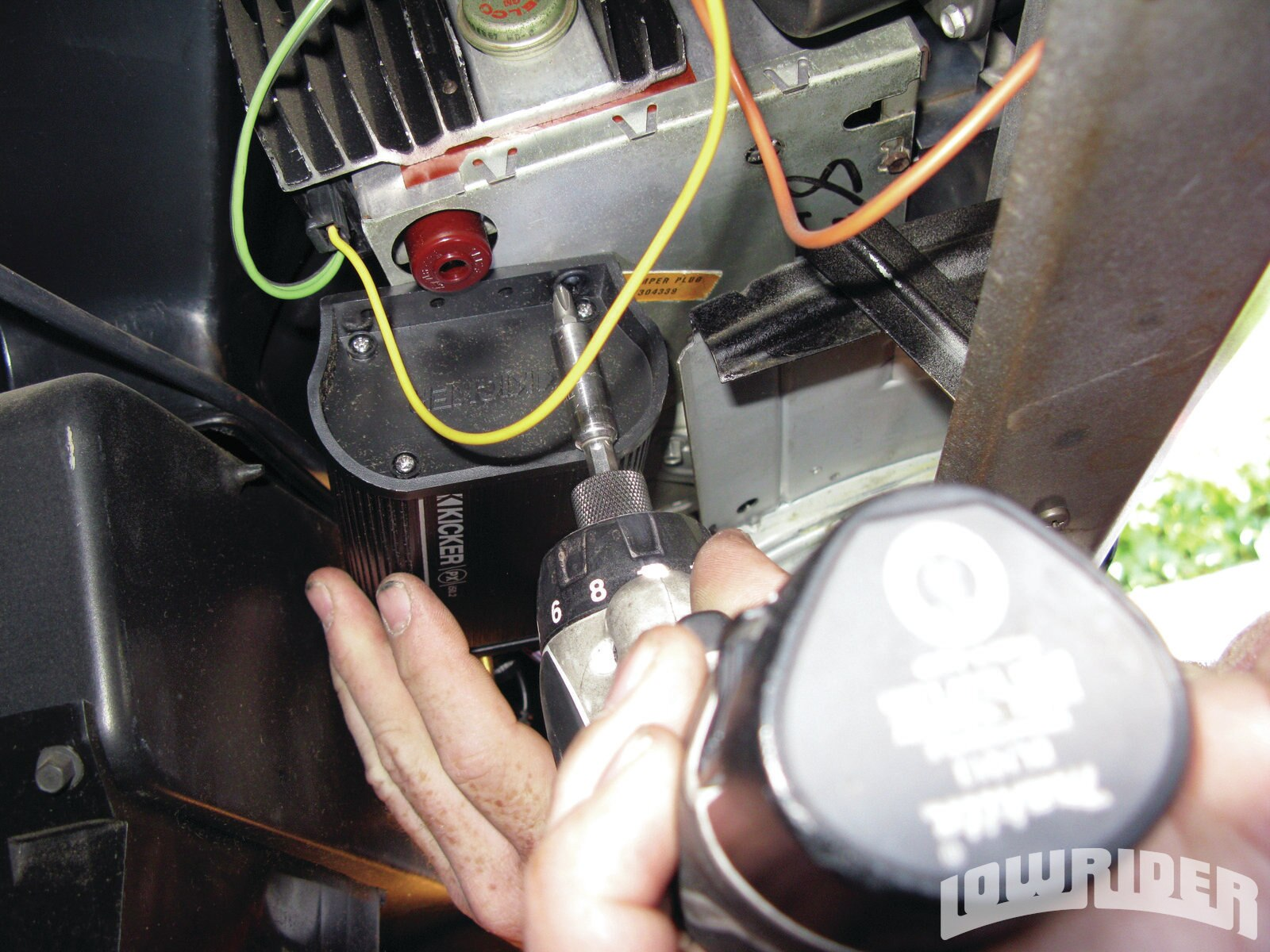 <strong>10</strong>. The black box of the PXi50.2 was then attached to the bottom of the stock radio underneath the dash.