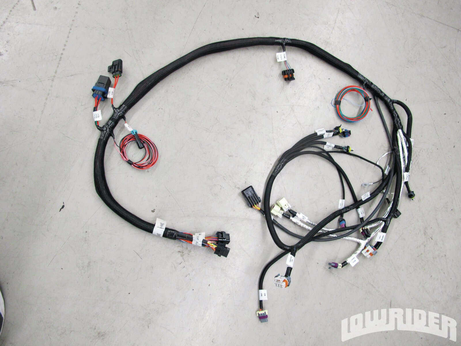 <strong>6</strong>. The main harness is now labeled and ready to be routed and plugged in.
