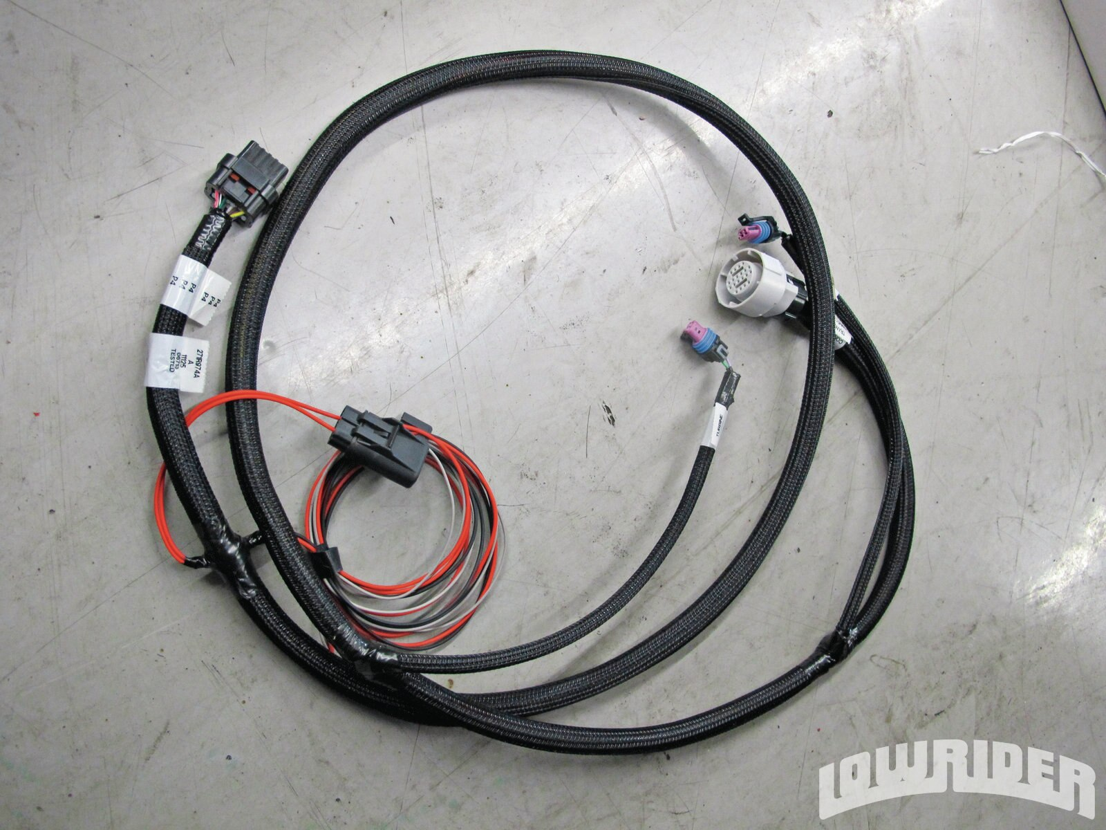 <strong>13</strong>. The transmission harness was ready to be installed.
