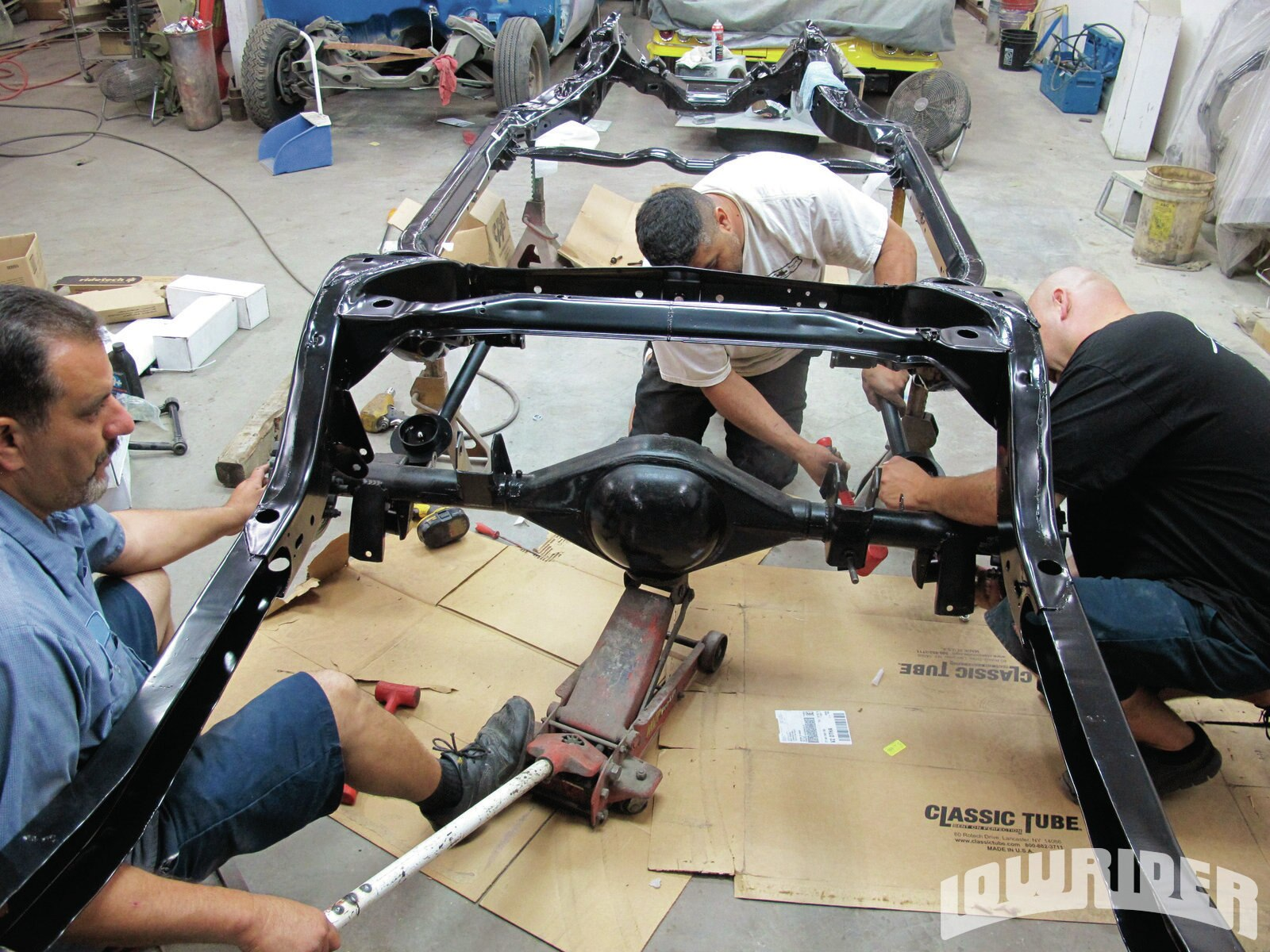 <strong>3</strong>. With the lower control arms installed, Luis and his crew were allowed to align the Currie rear end.