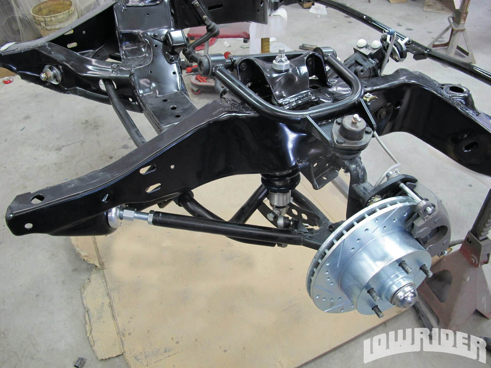 <strong>19</strong>. With the rotor bearings lubed and the calipers loaded with brake pads, they were bolted on.