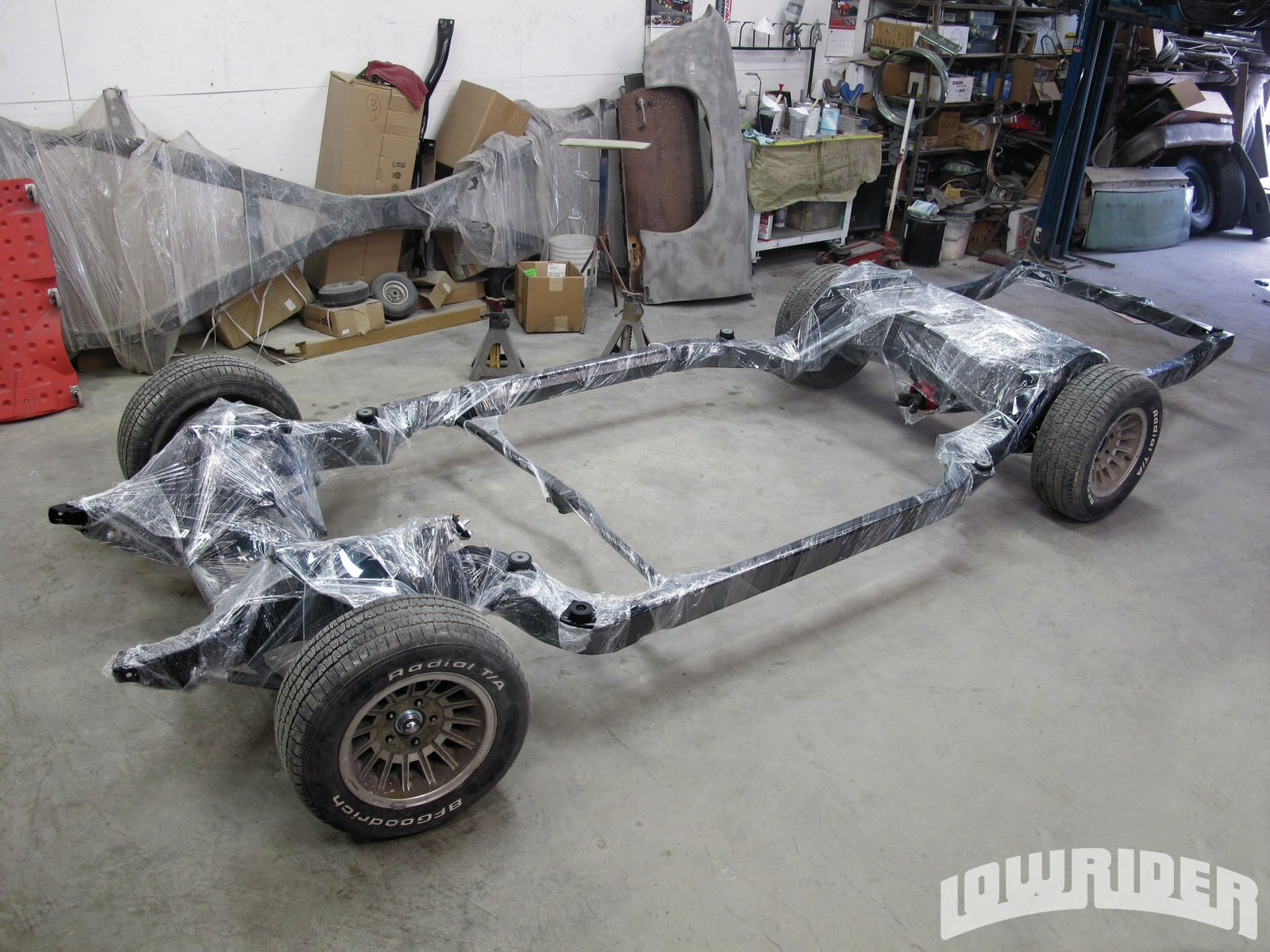 <strong>31</strong>. To protect the frame from overspray, it was wrapped with shrink-wrap and will be bolted up with it fully covered, as you can see.