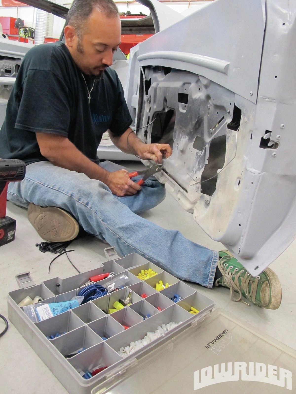 <strong>18</strong>. Mario worked on finishing the wiring for the actuator.