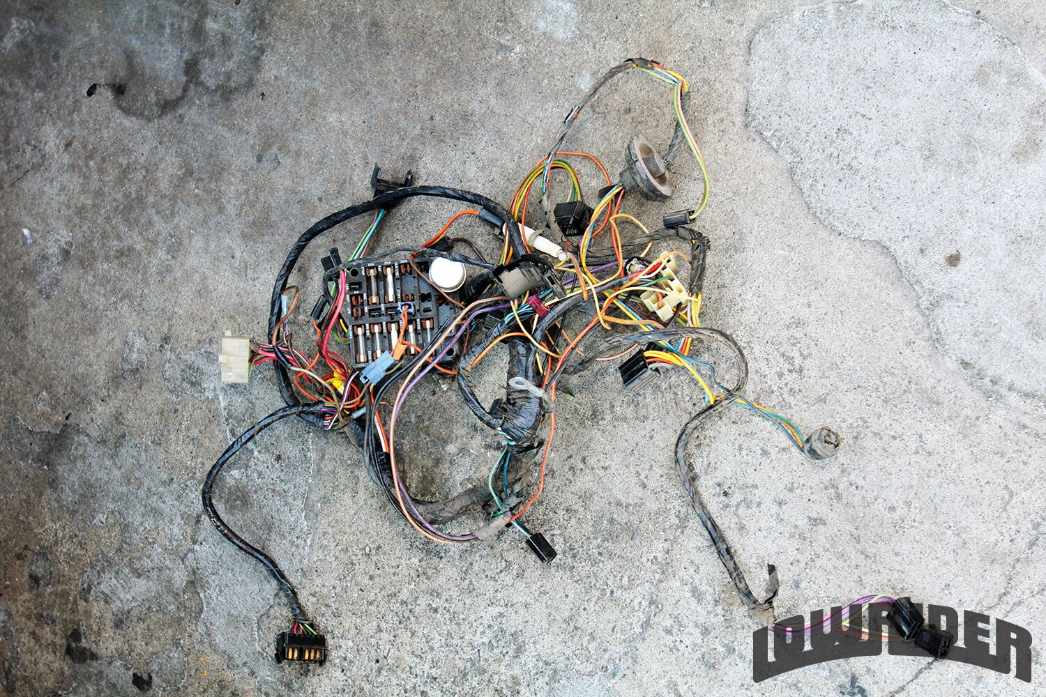 <strong>2</strong>. The old harness was ripped out of the car.