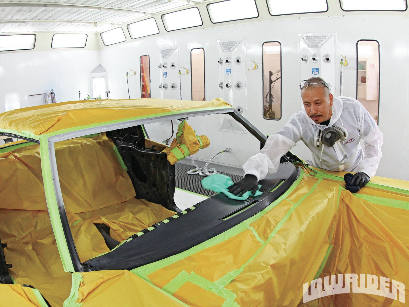 <strong>8</strong>. Cleaning and prep is the key to a clean paintjob and as you can see, the car is wiped down several times before the painting is even started.