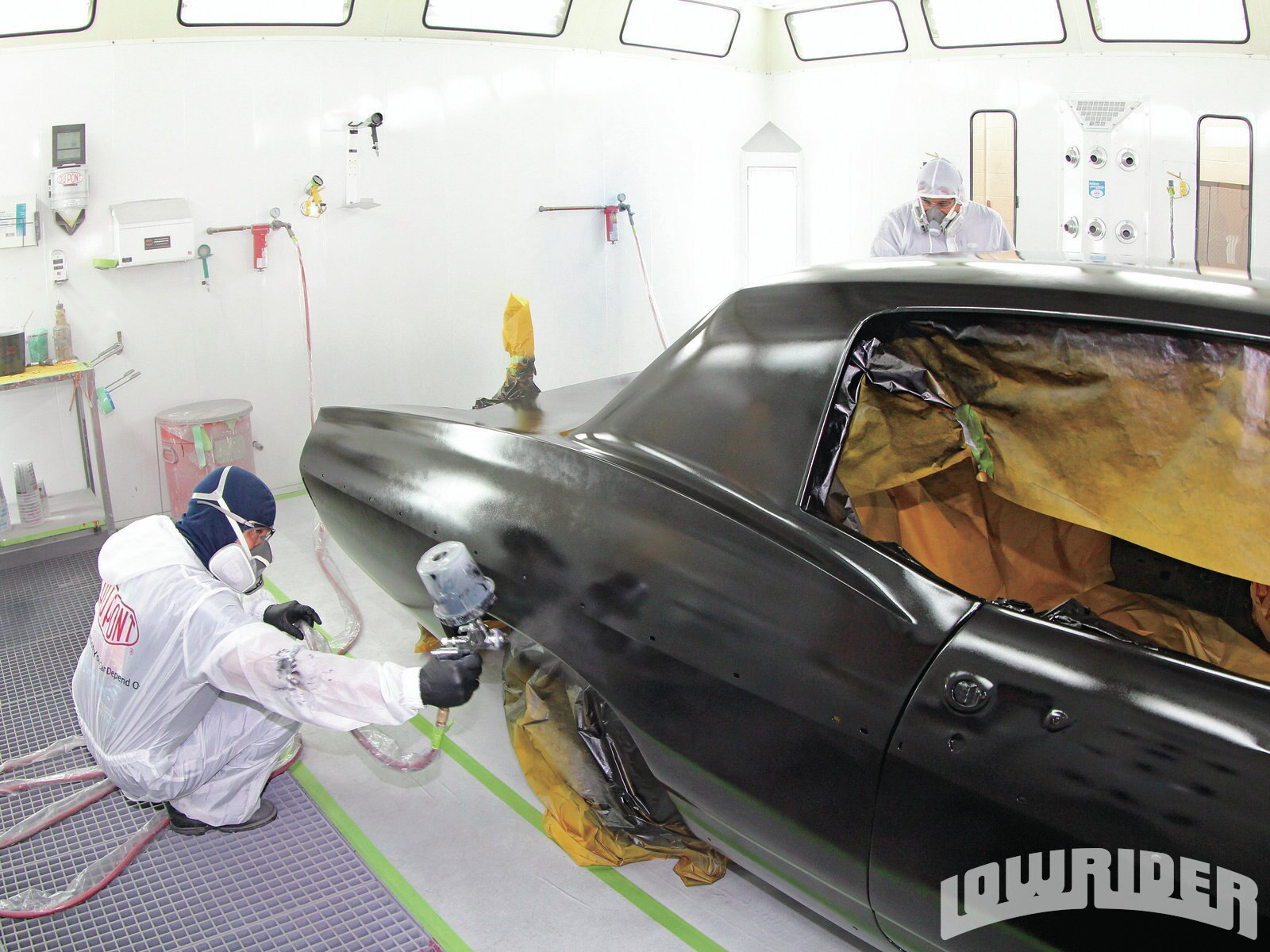 <strong>34</strong>. After a long day of painting the car, it was almost at the end of the paint session as the final coats of paint clear were applied.