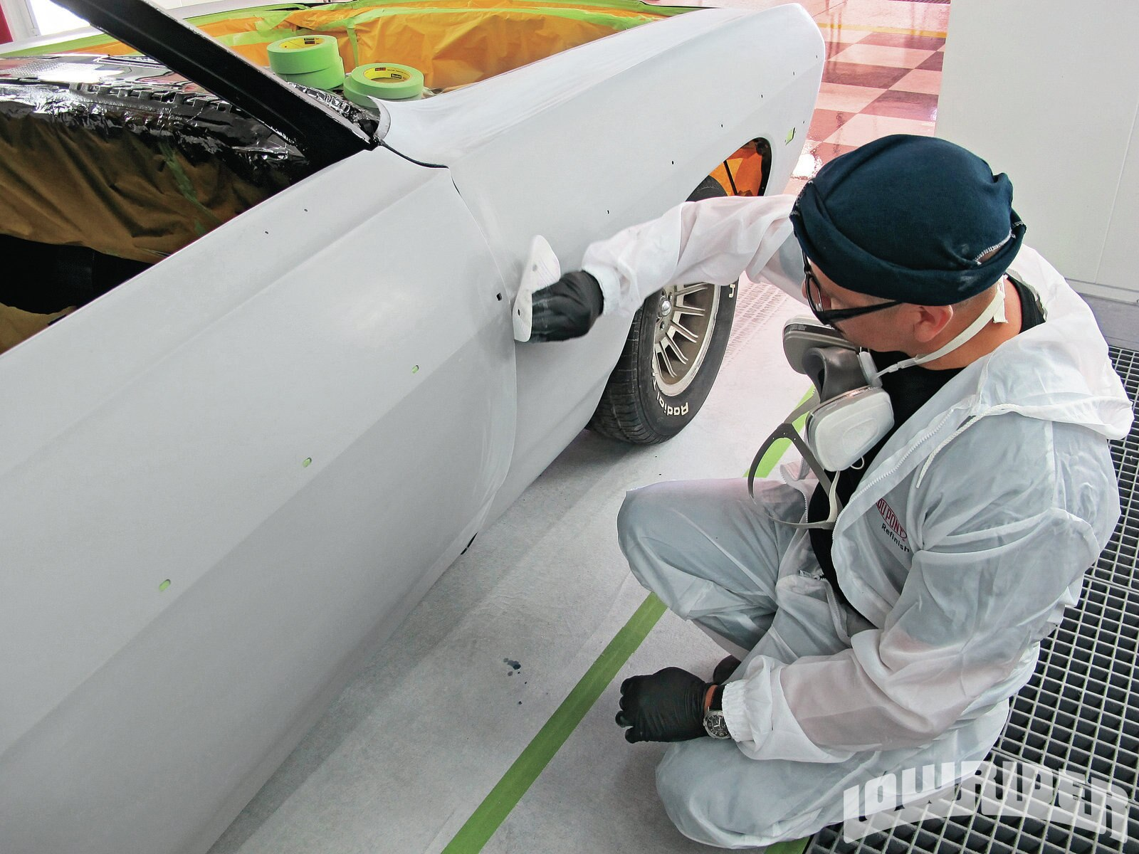 <strong>11</strong>. Before the car was masked up, the bodywork was touched up to remove any oil and residue that might cause a paint reaction.