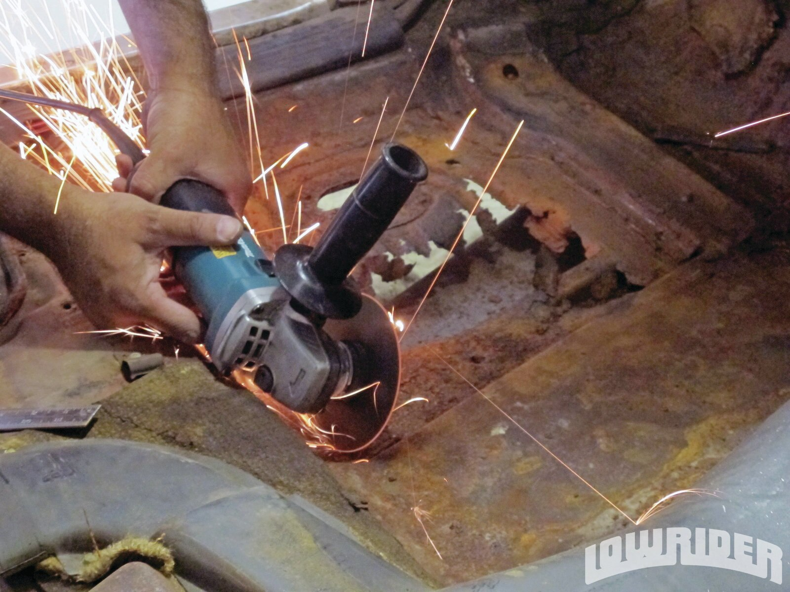 <strong>6</strong>. There are a few ways to cut out metal; we choose to use a Makita grinder equipped with cut off wheel.