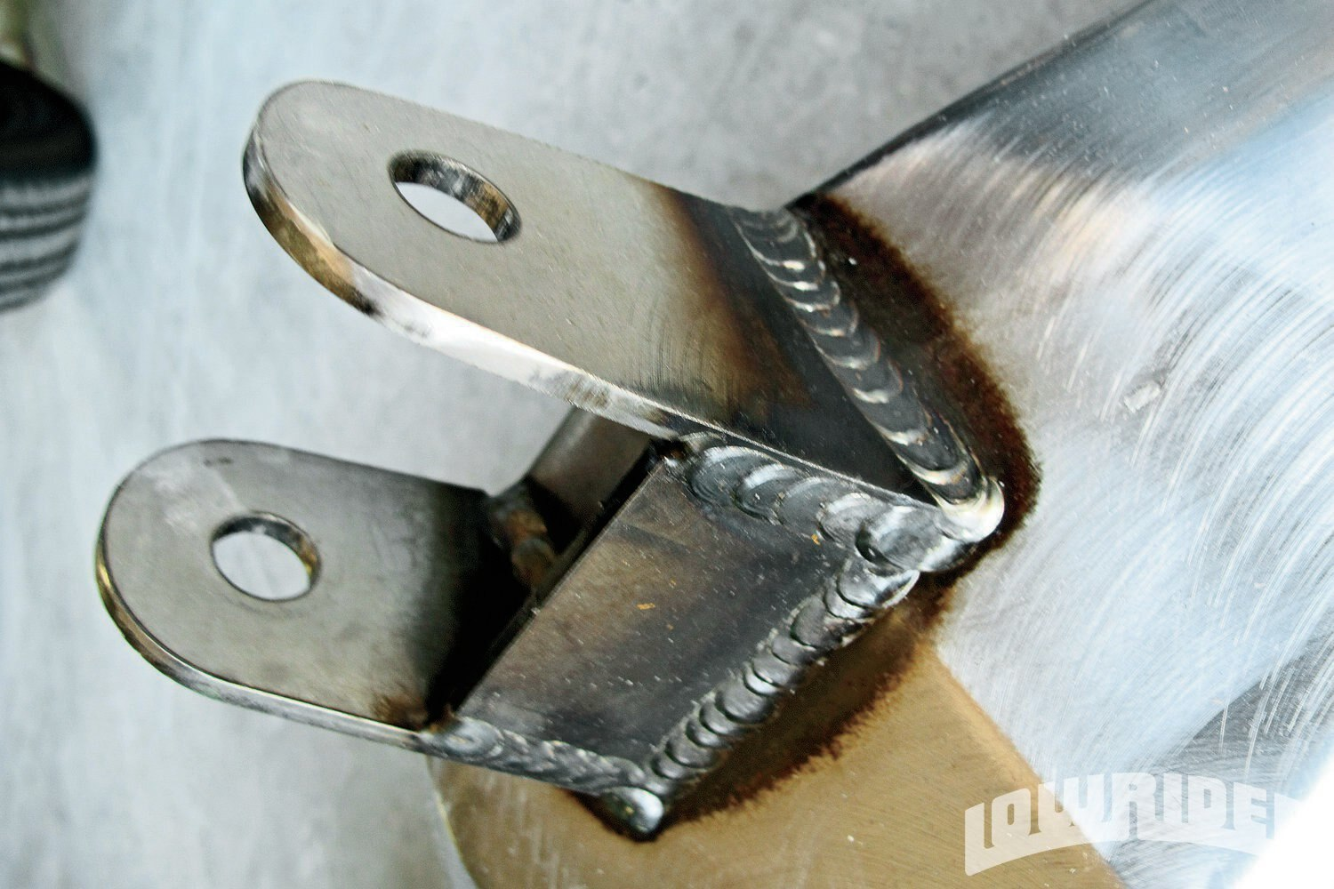 <strong>24</strong>. This new reinforced bracket will help keep the wishbone axle track straight.