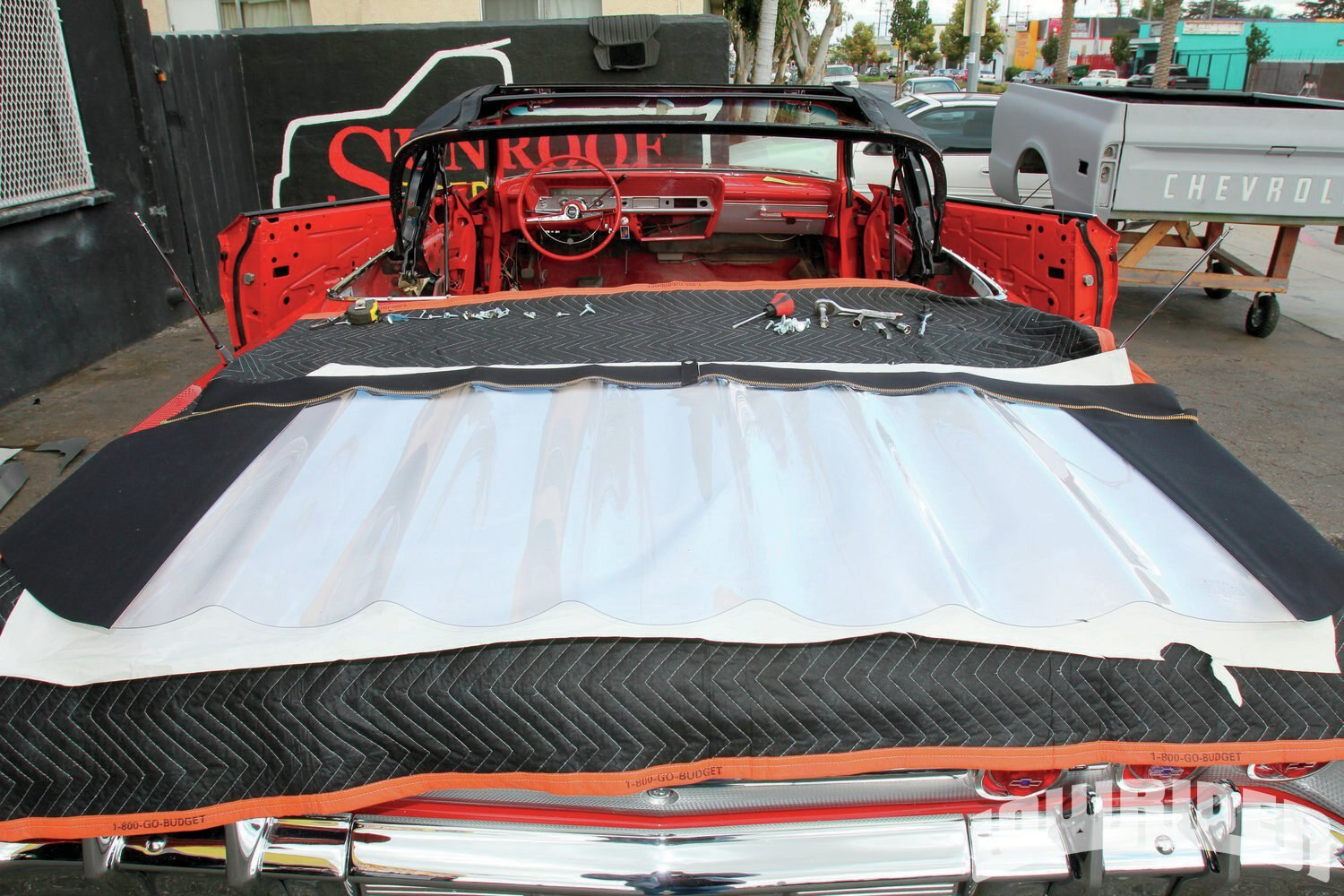 <strong>6</strong>. While the fill padding was being installed, the back window was left out to allow the sun to let the material stretch out.
