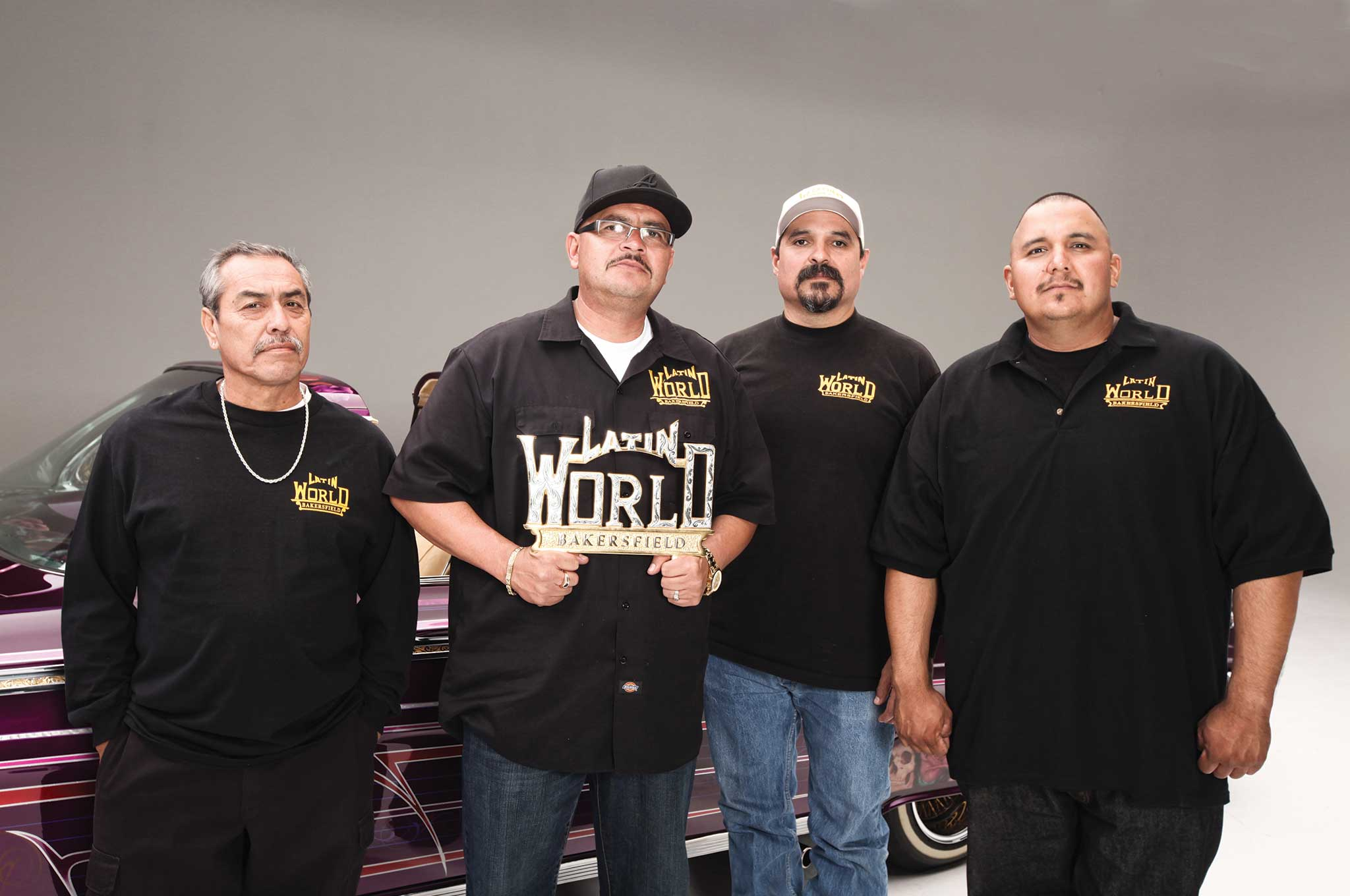 Robert Arreola holds his Latin World plaque up proud among his loyal members.