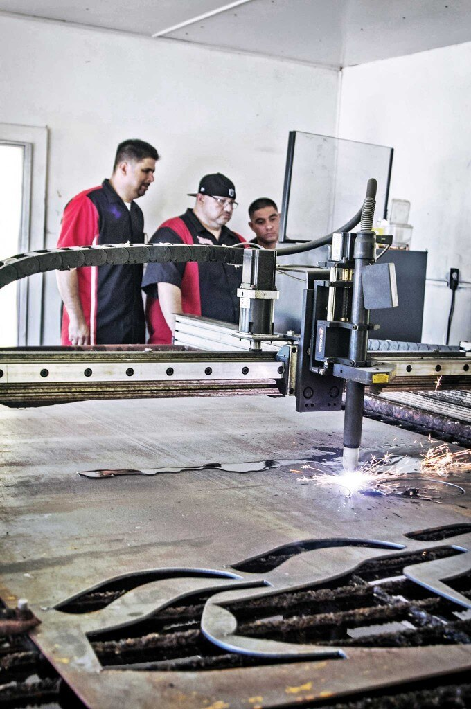 A custom fab company with a CNC machine, plasma water table, and laser-cutting machine at your service