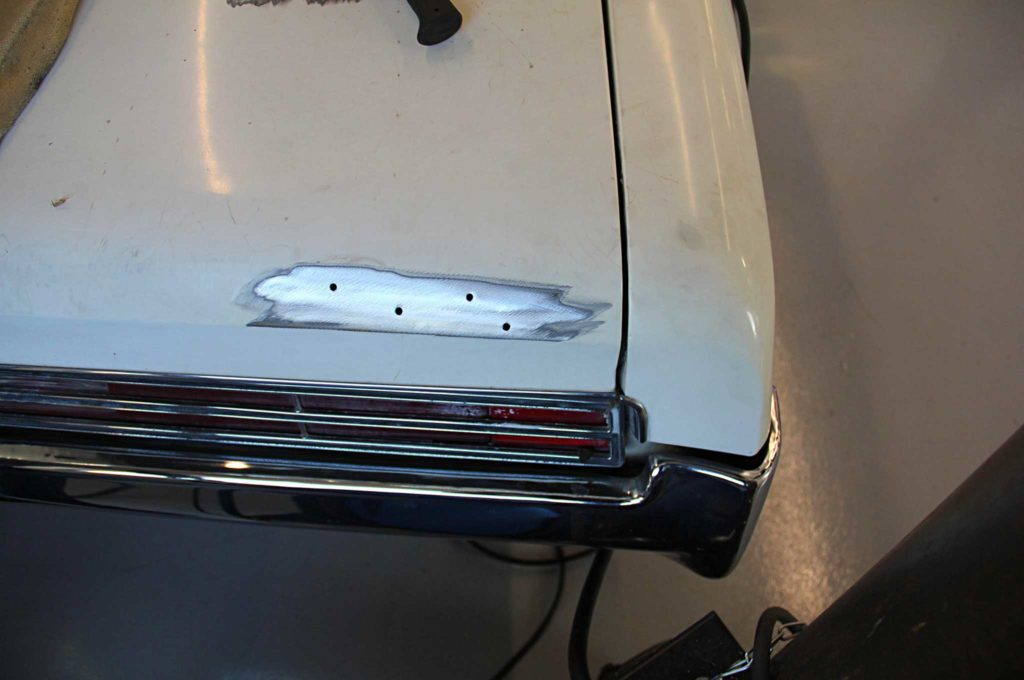 refining the fine lines of project riviera boat tail trunk badge bare metal