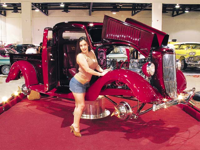 Cutie Christy poses on Sal Sierra's '36 Ford trokita.