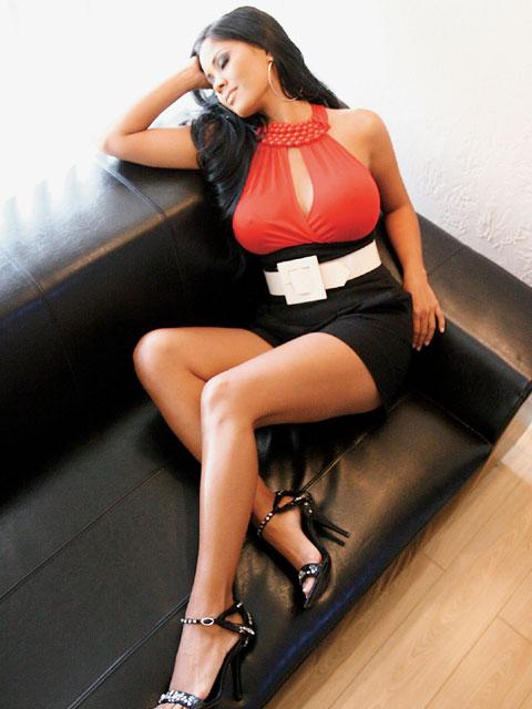 Lrms Z Miss Issa Sitting On Sofa