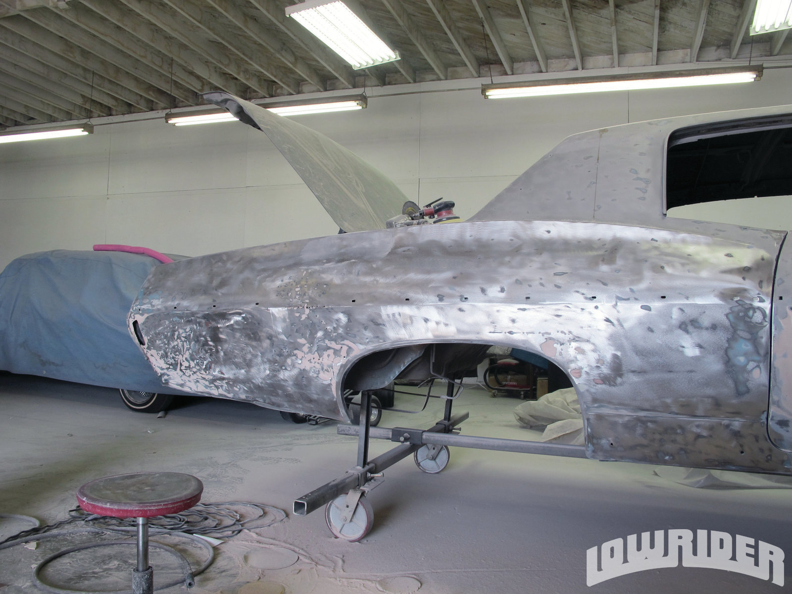 <strong>6</strong>. With the quarter panel in bare metal, you can see that it was still in workable condition and we had the option of saving it.