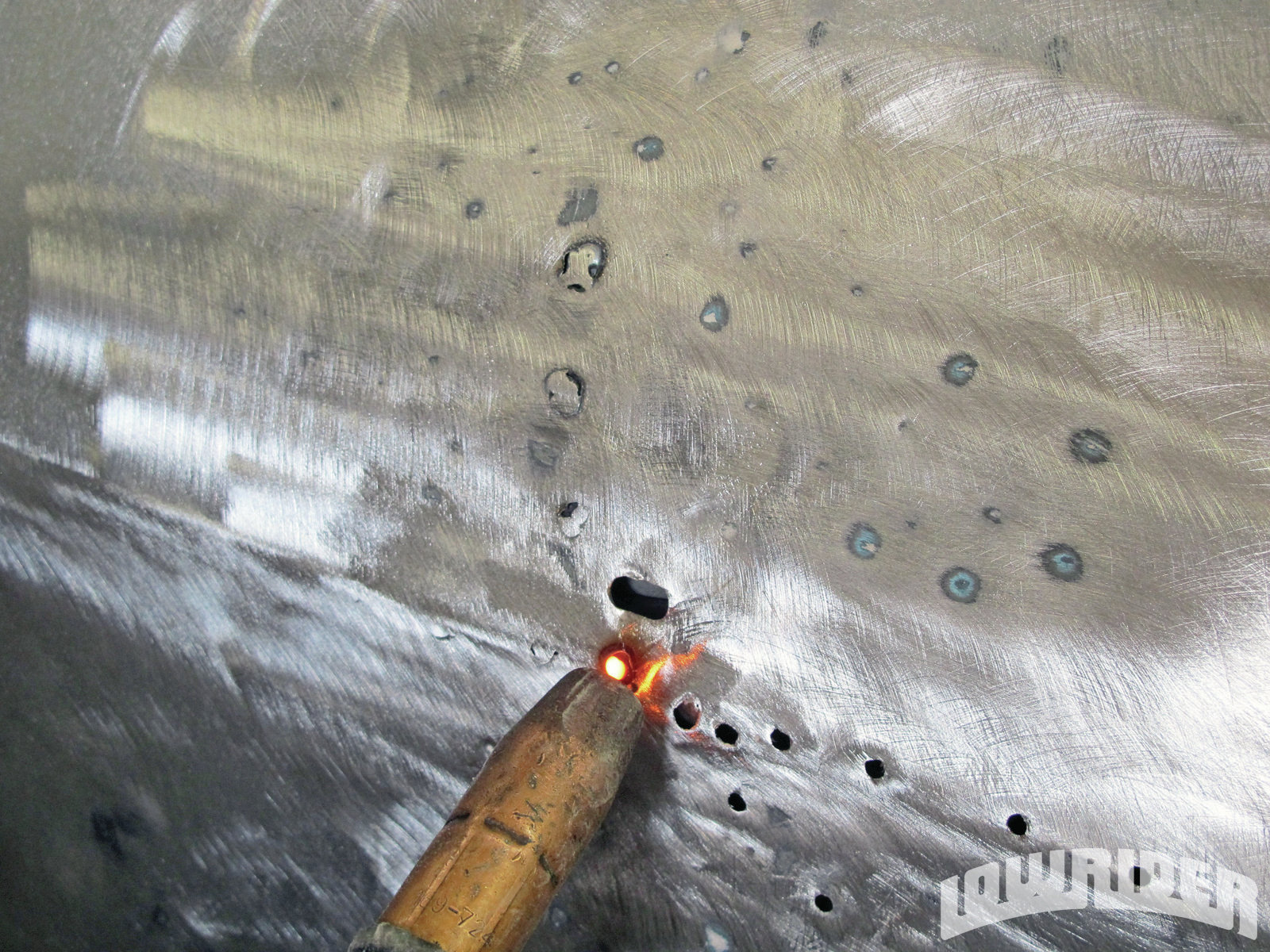 <strong>16</strong>. Using a copper spoon, the unwanted holes had been filled.