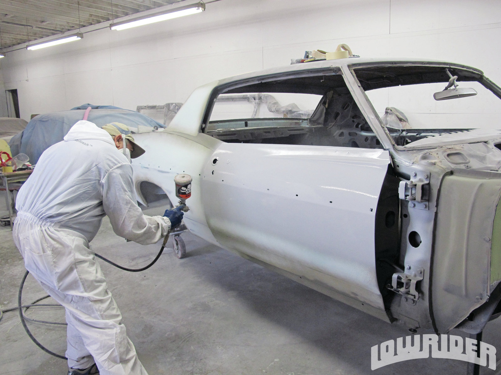 <strong>26</strong>. Jesus gave the car a dry coat to avoid any unwanted runs in the primer. Jesus will repeat this process thoughout the area that needed to be protected.