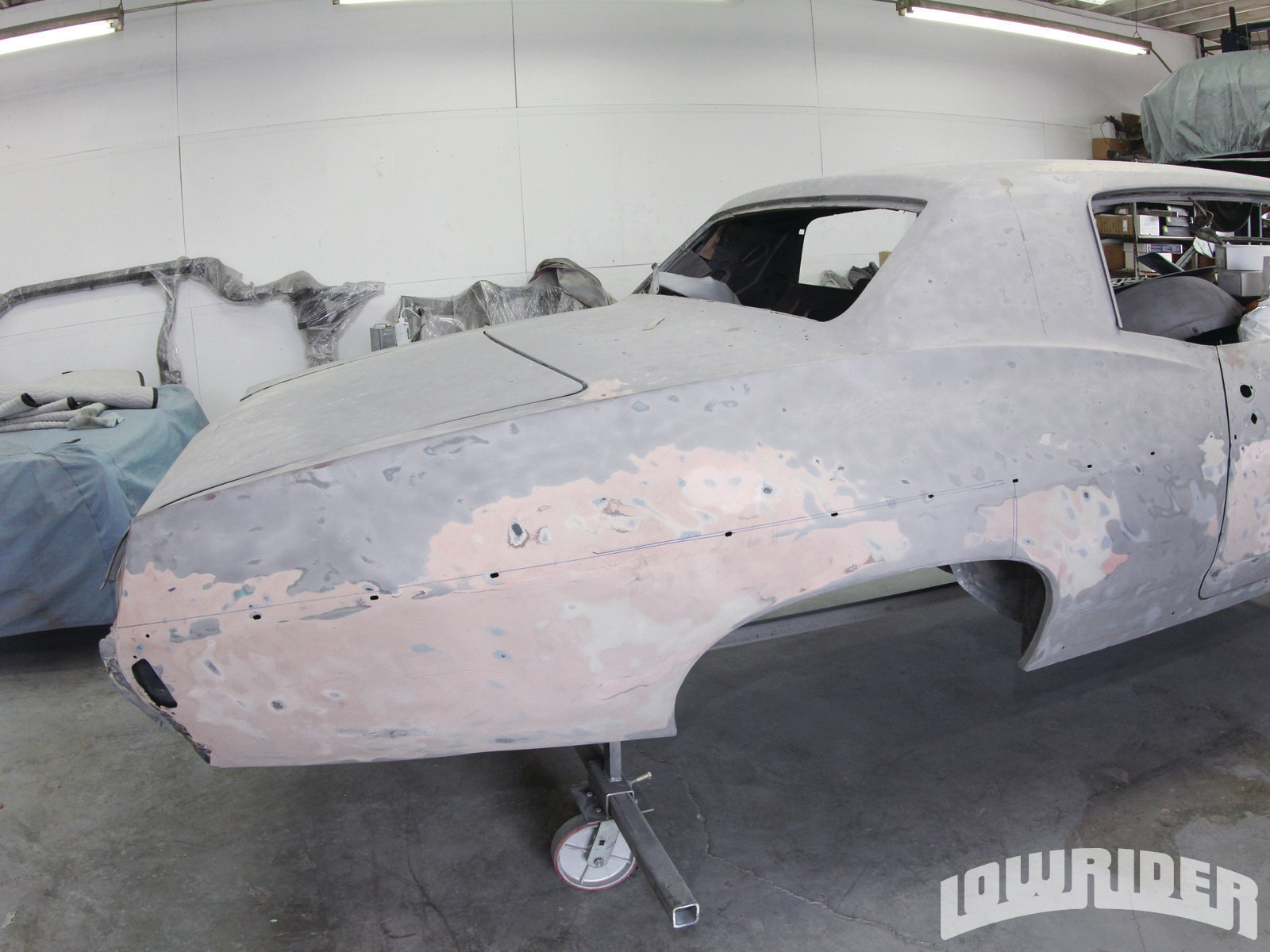<strong>2</strong>. This quarter panel had all of its paint removed where we found this bondo filler surprise.