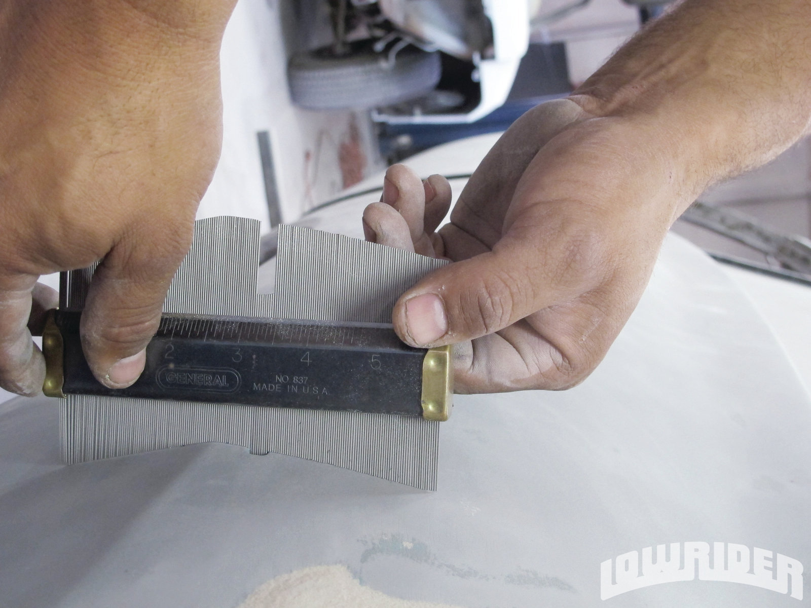 <strong>10</strong>. Using a shape finder, we could determine the right depth needed on the quarter panel.