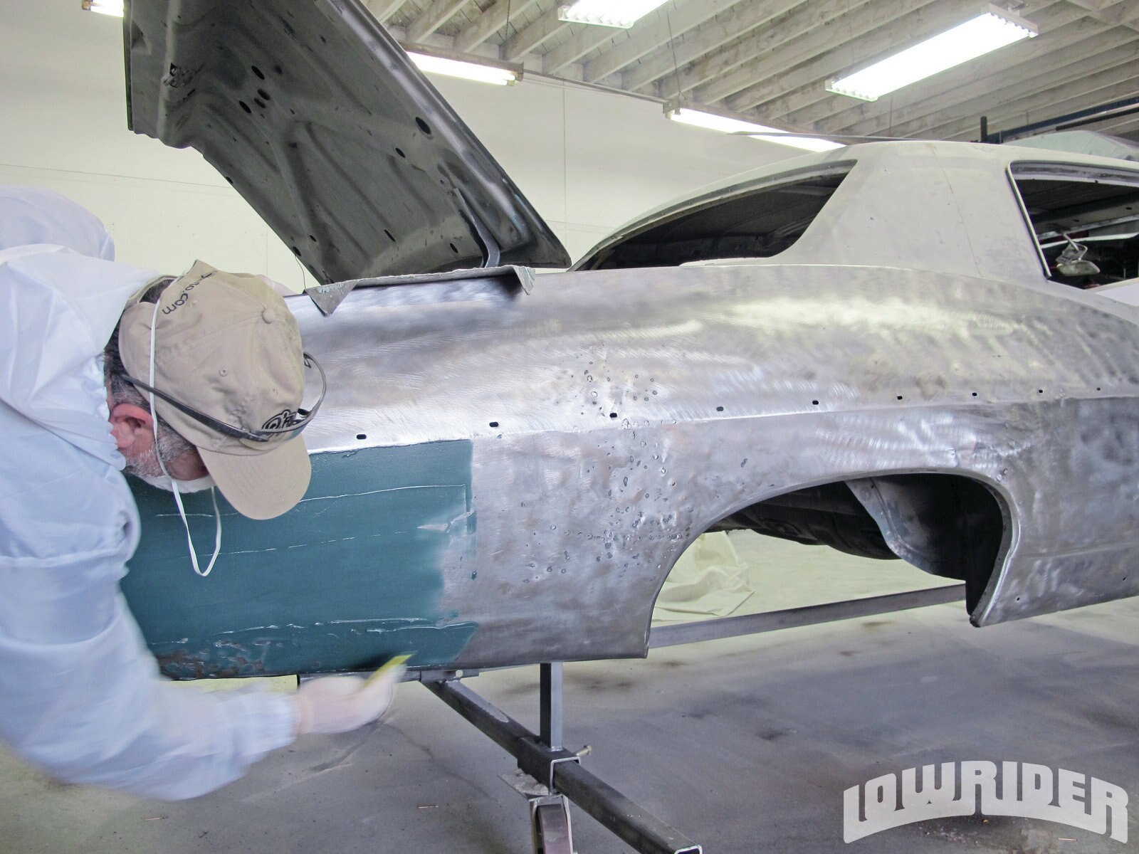 <strong>21</strong>. A thin coat of fiberglass was used to give the quarter panel some strength.