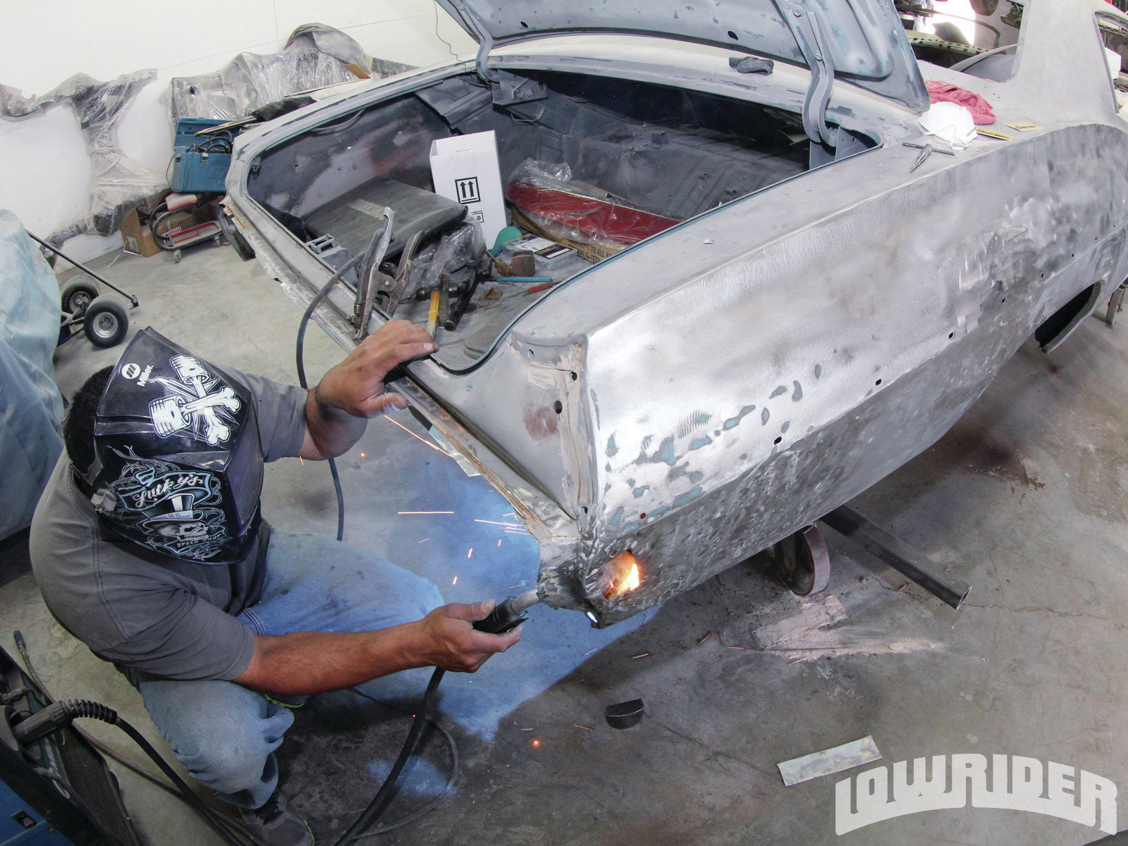 <strong>14</strong>. Luis welded the quarter panel in place as it had come loose from the original damage.