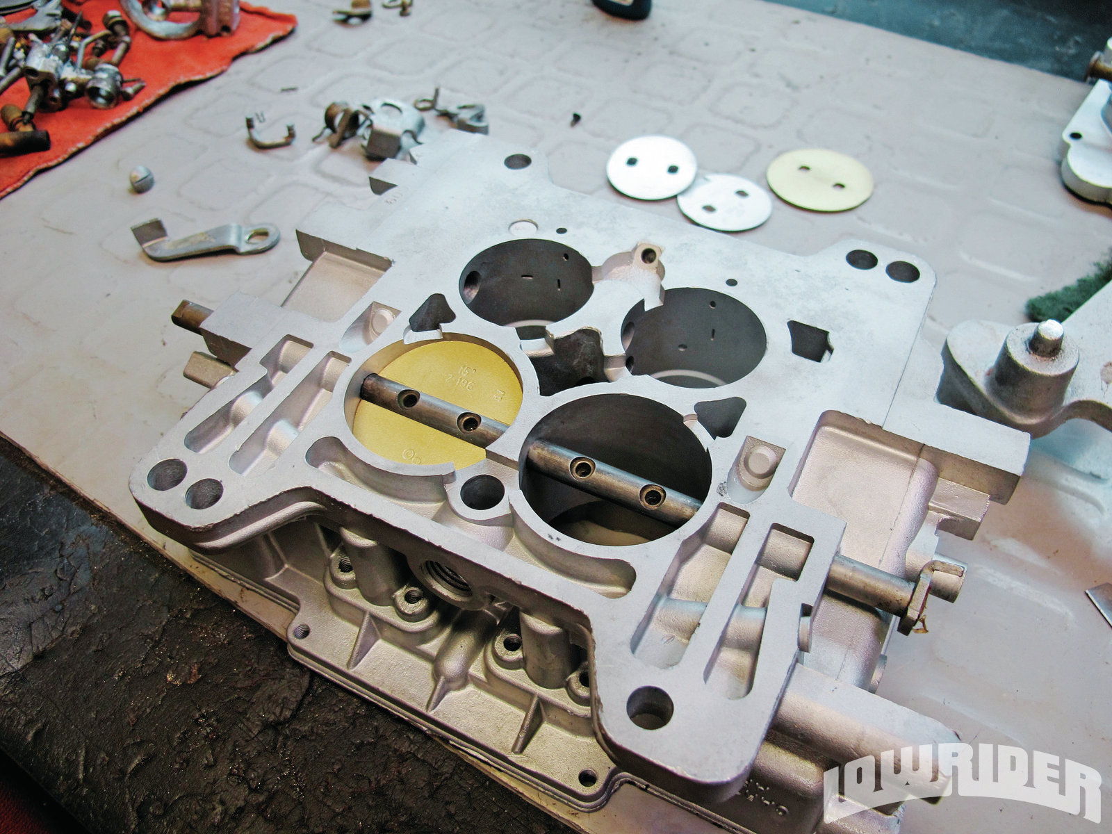 <strong>9</strong>. The carb was all clean and OJ started the reassembly of the carburetor.