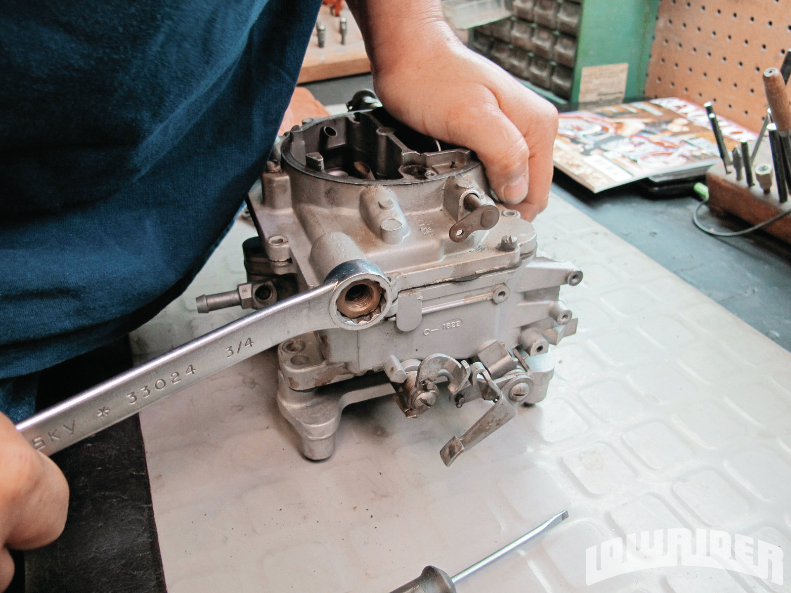 <strong>2</strong>. OJ tore down the carburetor, making sure not to lose any of the small parts.