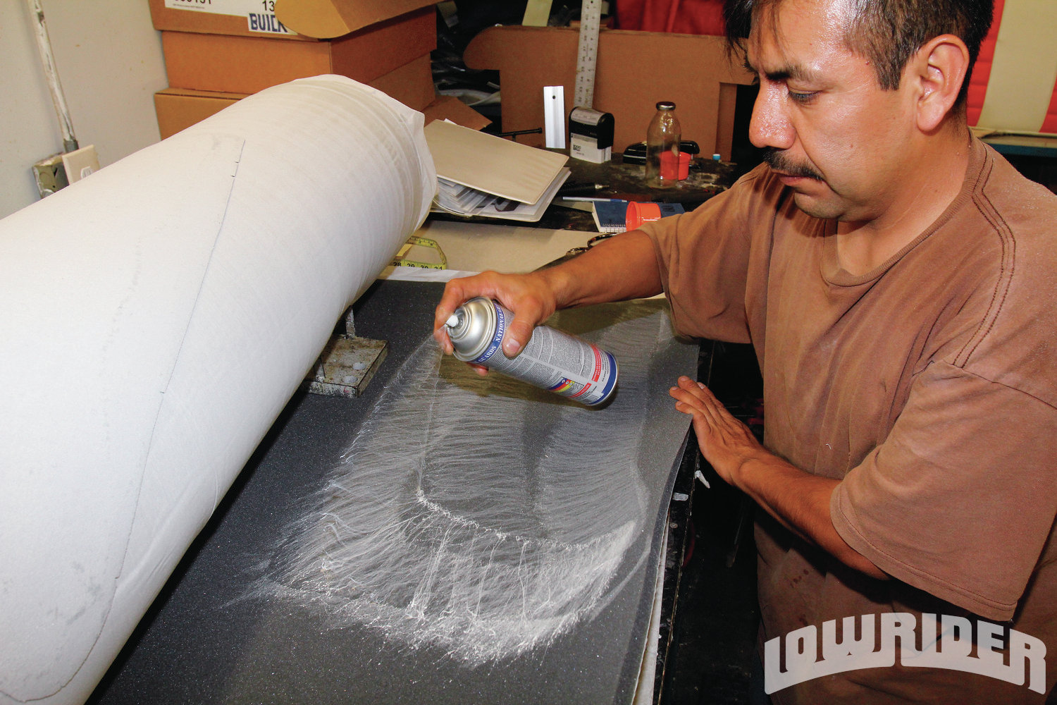 <strong>16</strong>. The backing or foam also needed to have glue sprayed onto it. This will allow the foam panel and leather to make a good bond once it dries.