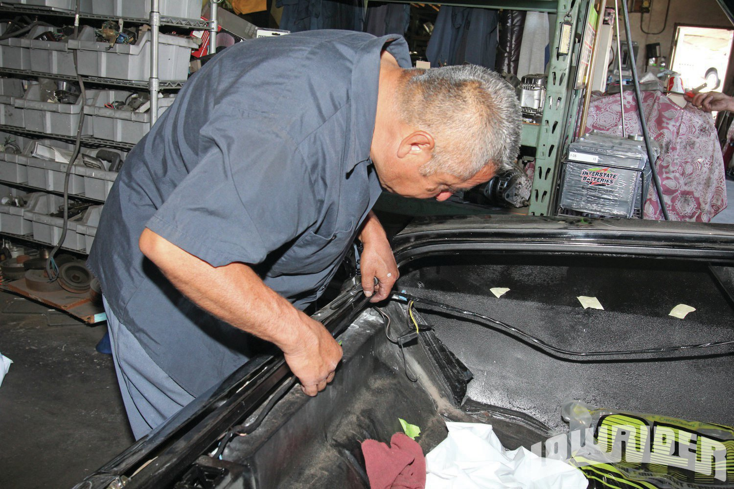 <strong>5</strong>. Cacho ran the new wiring to each of the rear lights.