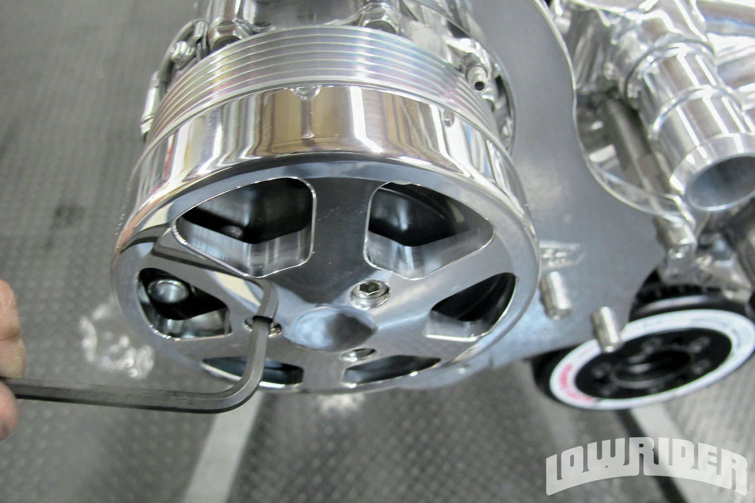 <strong>13</strong>. The compressor needed to be dressed up. We used a billet cover that will tie in all the billet pulleys.