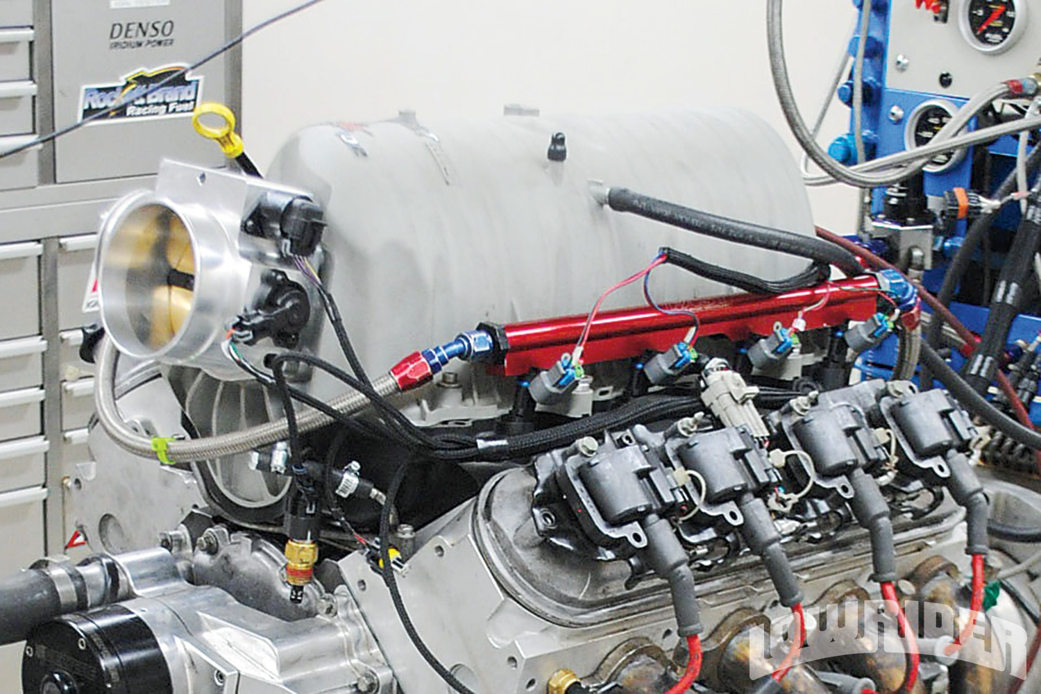<strong>10</strong>. The final upgrade for the test mules was this LSXRT intake and matching 102mm throttle body from Fast. Possibly oversized for these smaller motors, the intake insured we would get the maximum performance from the TEA heads and Crane cam. Note also the 42-pound injectors and wiring harness for the Holley Dominator EFI system.